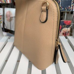 Saddle cross body bag in taupe